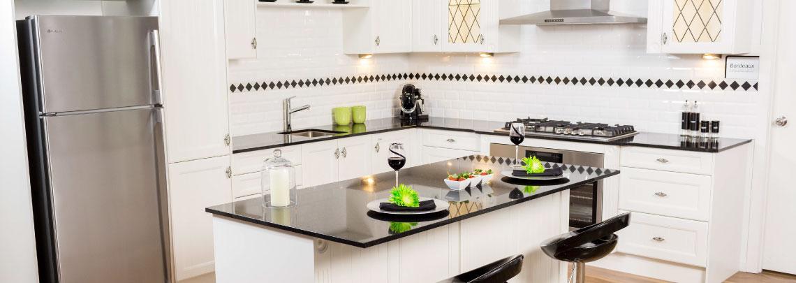 Modern White Kitchen With Black Granite Bench Top