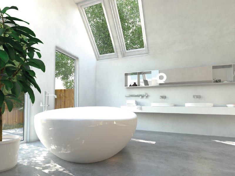 freestanding bathtub under skylight